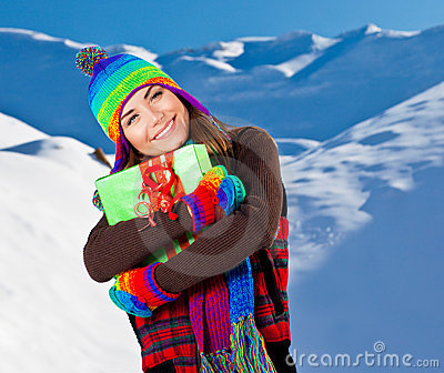Happy girl with Christmas gift, winter portrait