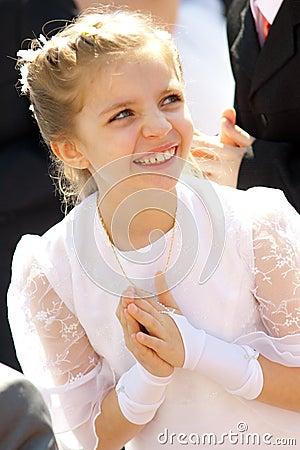 Happy girl in communion dress