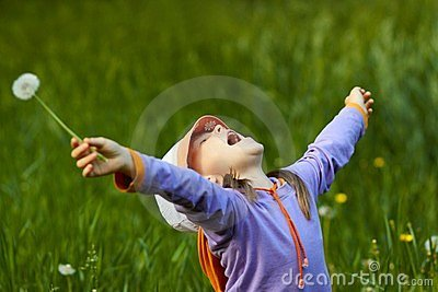 Happy girl with dandelion