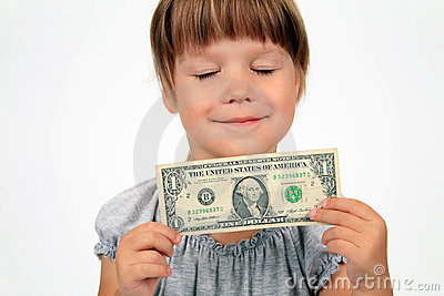 The happy girl with dollar in hands