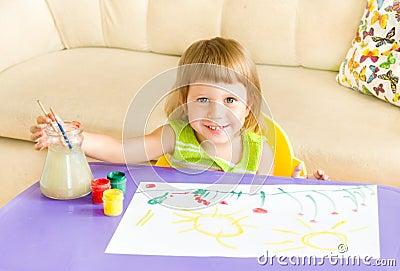 The happy girl draws paints