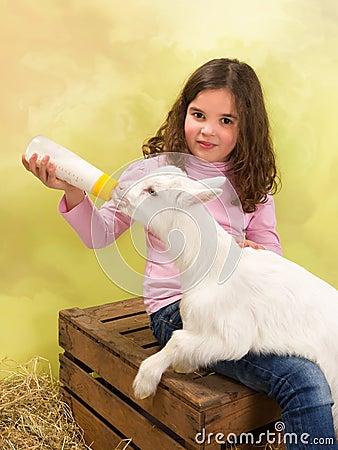 Free Happy Girl Feeding Baby Goat Stock Image - 38598231