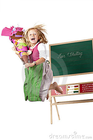 Happy girl on first school day jumps in the air