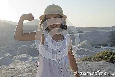 Happy girl flexing muscle