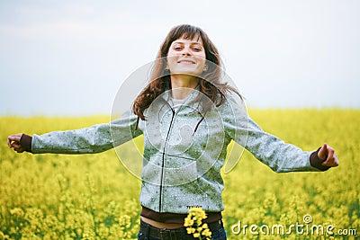 Happy girl in flower field