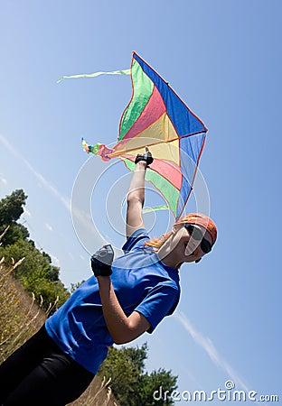 Happy girl flying kite