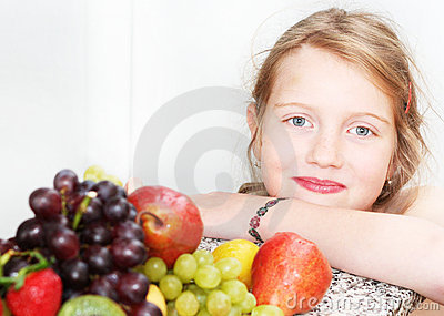 Happy girl with fruits
