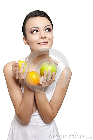 Happy girl with fruits lemon and green apple