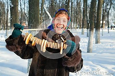 Happy girl in  fur coat with round cracknel