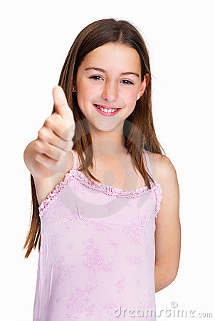 Happy girl gesturing a success sign against white