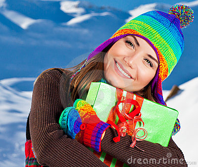 Happy girl with gift, winter outdoor portrait