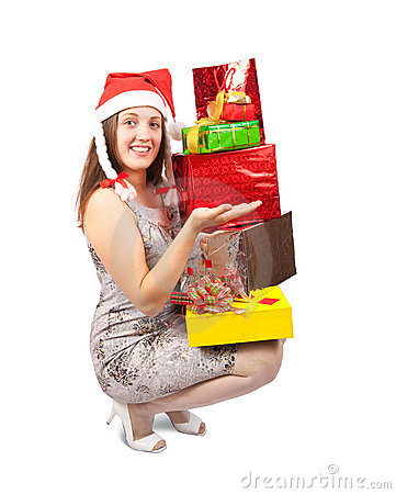 Happy girl with gifts isolated over white