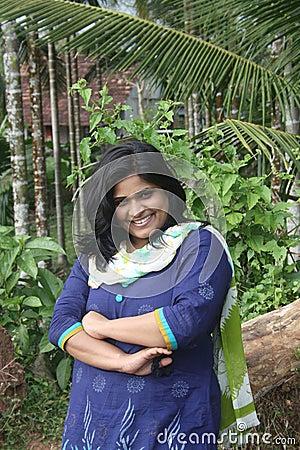Happy Girl giving Joyous Smile in Nature Backgroud