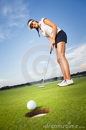 Free Happy Girl Golfer Putting Ball Into Hole. Stock Photos - 26802623