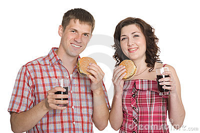 Happy girl and a guy eating hamburgers