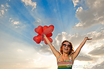 Happy girl with heart shaped baloons