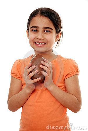 Happy girl holding chocolate egg