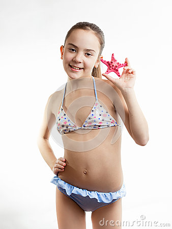 Free Happy Girl In Swimming Suit Showing Red Starfish Stock Photography - 55266922