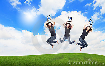 Happy Girl Jump show tablet pc with sky