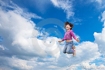 Happy girl jumps into the sky