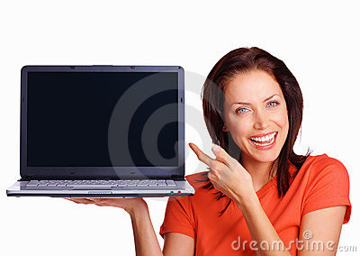 Happy girl with laptop pointing to blank screen