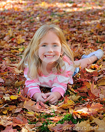 Free Happy Girl Laying In Leaves Royalty Free Stock Photos - 27252268