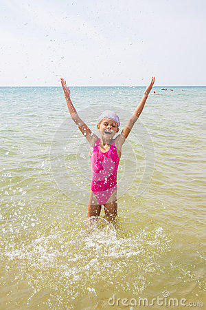 Free Happy Girl Let Up Splashes Water Standing Royalty Free Stock Photo - 81224865
