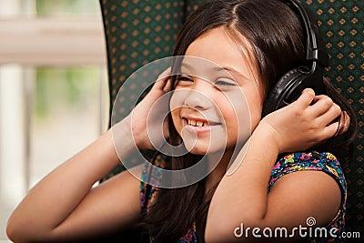 Happy girl listening to music