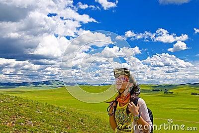 Happy girl on meadow,sky