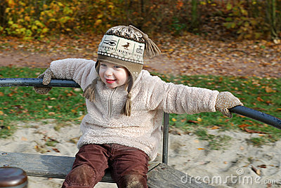 Happy girl on a merry-go-round