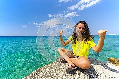 Happy girl near the ocean