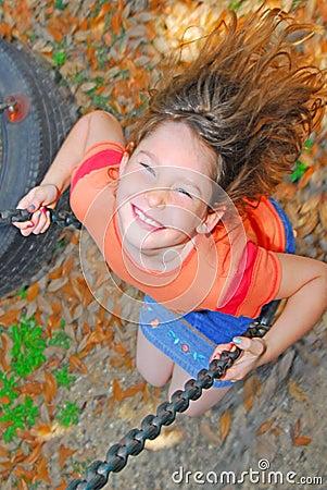 Free Happy Girl On Swing Stock Image - 9023581