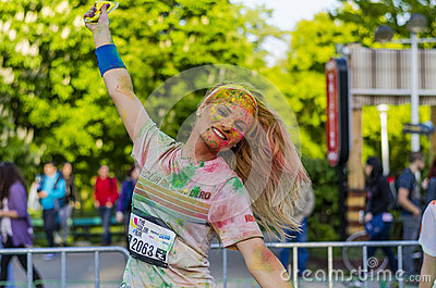 Happy girl painted with colored powder Editorial Image