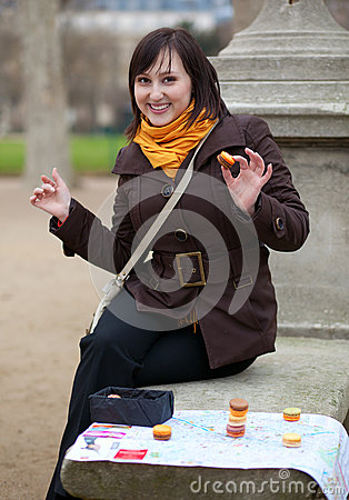 Happy girl in Paris with tourist map