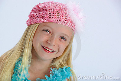 Happy girl in pink woollen hat
