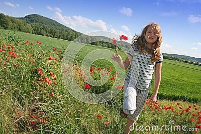 Happy girl on poppies field