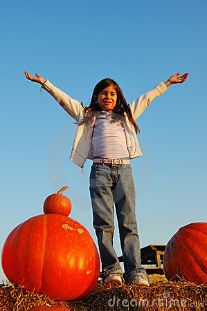 Happy girl and pumpkins