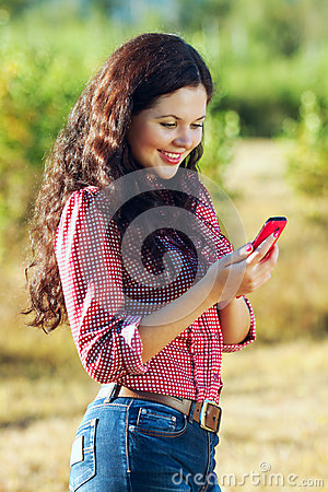 Happy girl reading a text message