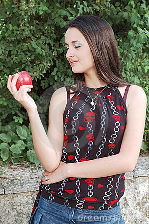 Happy girl with red apple