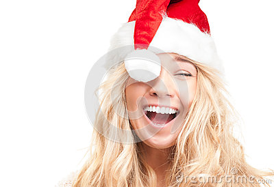 Happy girl in red santa hat isolated on white.