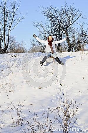 Happy girl relaxing in winter