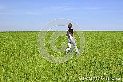 Happy girl run on the meadow