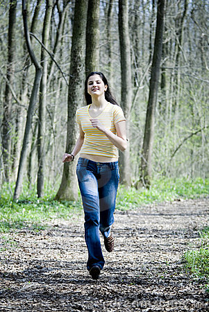 Happy Girl Running In Forest