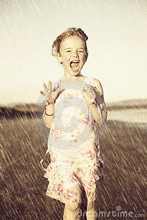 Happy girl running in rain
