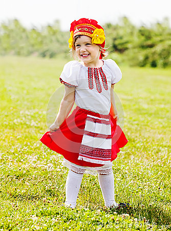 Happy girl in russian traditional folk clothes Stock Photo