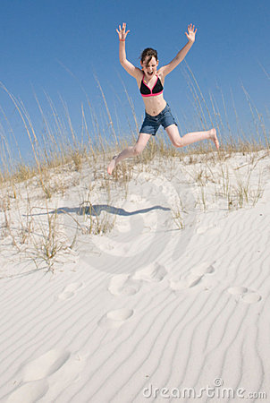 Happy girl on sand dune