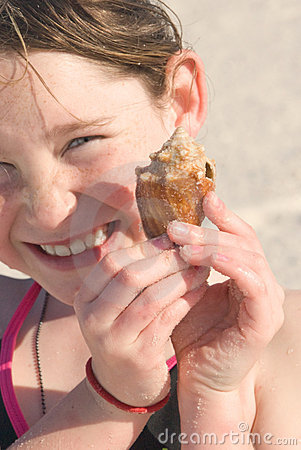 Happy girl with seashell