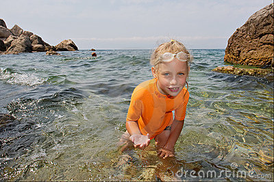 Happy girl shows jellyfish in hands