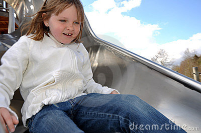 Happy girl on slide