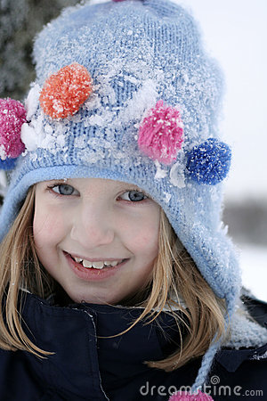 Happy girl in snowy wintry hat